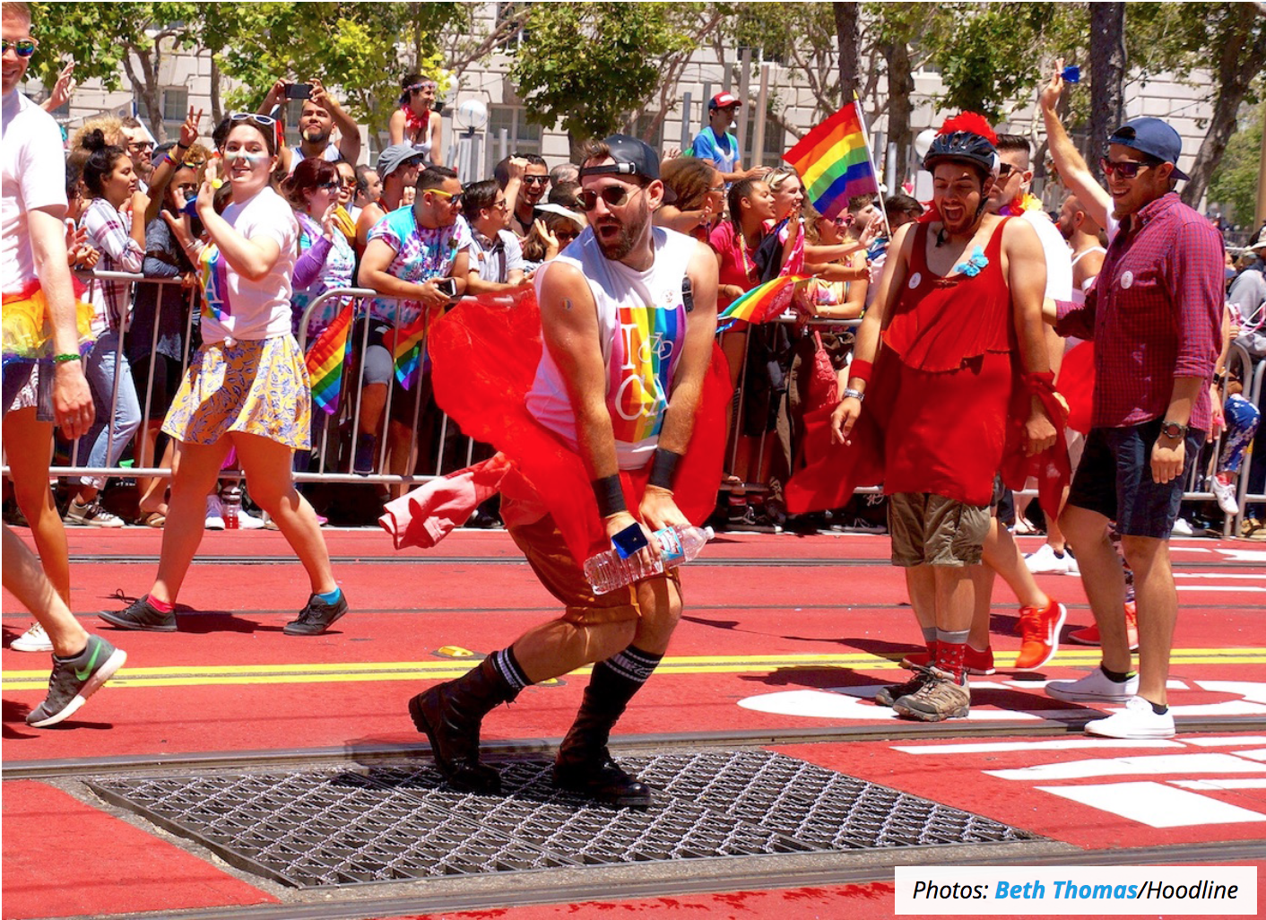 People dancing in colorful apparel at SF Pride celebration