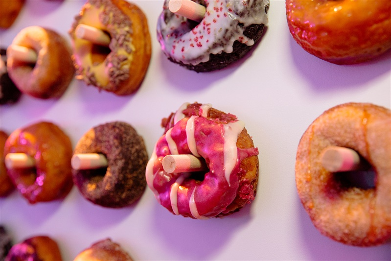 Yummy donut wall with flavors like Sweet Potato Marshmallow and Persimmon by Dynamo.