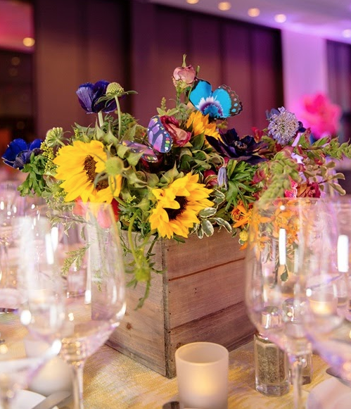 Low wildflower centerpieces with butterflies